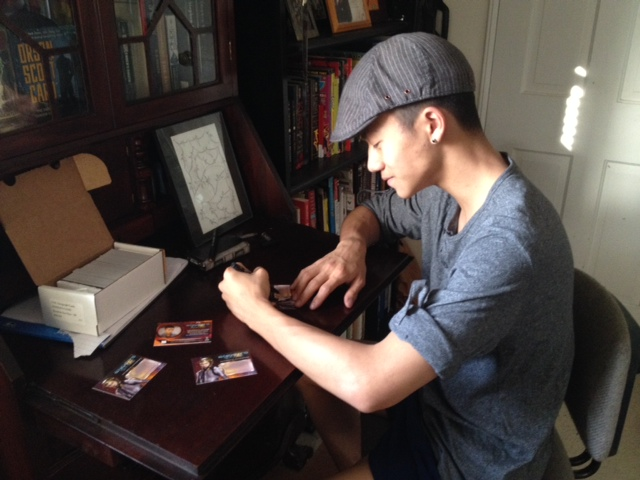 Brandon signs his Fly Molo character trading cards.